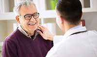 gettyimages529115218_provider_with_older_male_patient_200x118