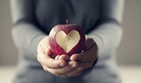 gettyimages161754720_hands_holding_heartbite_apple_200x118