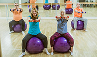 gettyimages1124688465_exercising_with_dumbells_and_balls_200x118