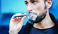 young_man_vaping_ecigarette_200x118
