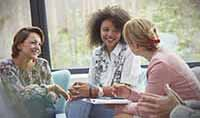 gettyimages922709618_three_women_talking_200x118 (1)
