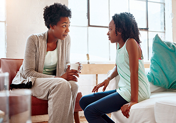 iStock857895554_africanamerian mom and daughter talking_350
