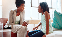 iStock857895554_africanamerican mom and daughter talking_200x118